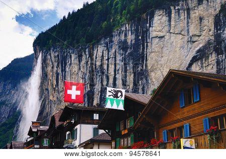 Houses in Lauterbrunnen (Switzerland) and Staubbach Falls