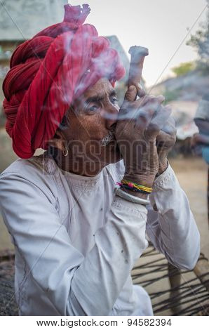 GODWAR REGION, INDIA - 12 FEBRUARY 2015: Rabari tribesman smoking chillum. Rabari or Rewari are an Indian community in the state of Gujarat.
