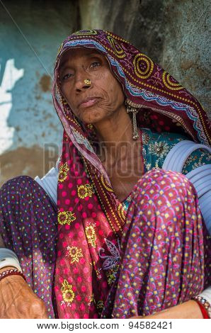 GODWAR REGION, INDIA - 13 FEBRUARY 2015: Rabari tribeswoman in sari decorated with traditional upper-arm bracelets and jewerelly. Rabari or Rewari are an Indian community from Gujarat.