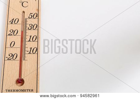 Thermometer Made From Wood On White Background