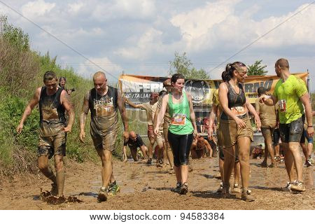 People Dirt With Mud During A Mud Run Competition