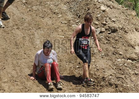 Two Women Going Down On A Steep Slope