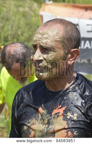 Portrait Of A Man Dirt With Mud
