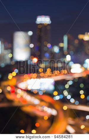 Night traffic light blurred. Big city lights background