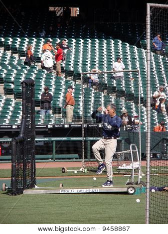 Padres Manager Bud Black Lifts Leg To Throws Pitch During Batting Practice