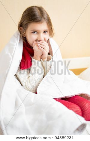 Sick Girl Wrapped In Blanket Coughing In Bed