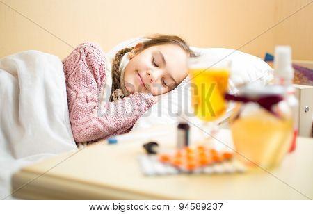 Portrait Of Sick Girl In Sweater Lying In Bed