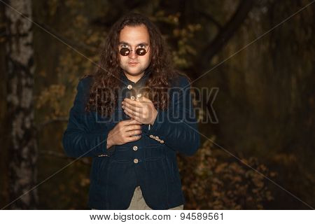 Man With Long Hair Holding A Candle