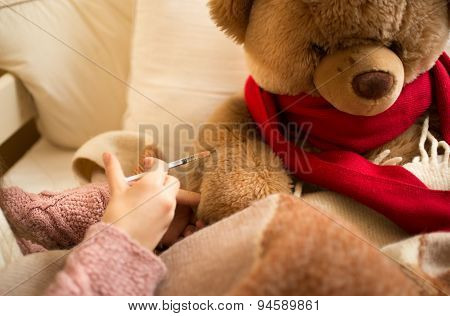 Closeup Of Little Girl Doing Injection To Sick Teddy Bear