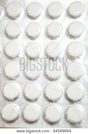 Macro Shot Of White Pills In Blister