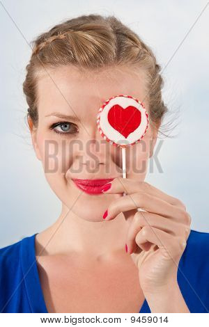 Beautiful Girl With Lollipop Heart In Her Hand