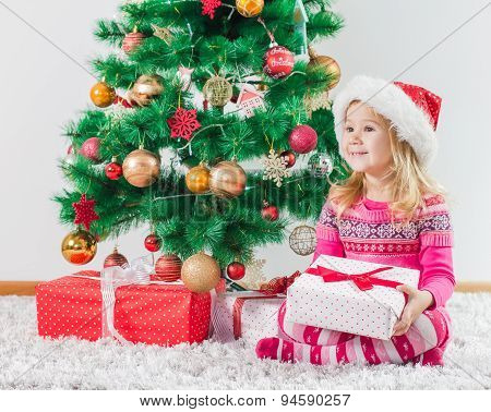 Happy Little Girl With Christmas Gift