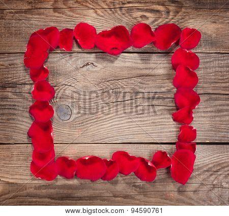 Design Element. Frame Of Rose Petals On The Old Boards