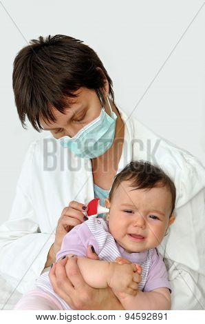 Doctor pediatrician and baby girl
