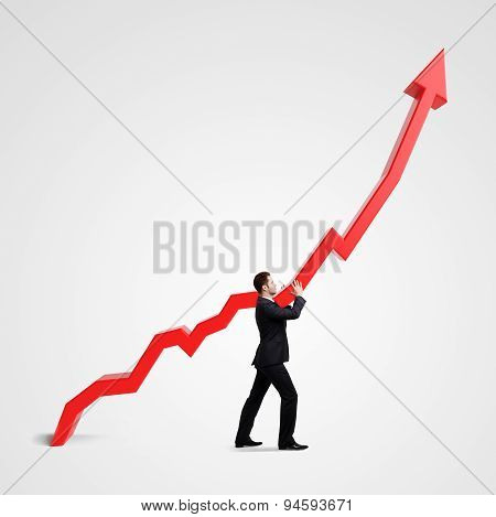 Businessman Holding Graph
