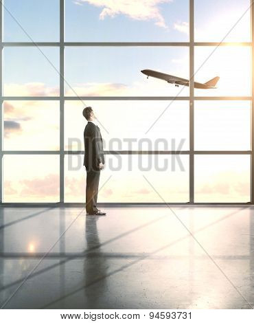 Businessman Looking To Airplane
