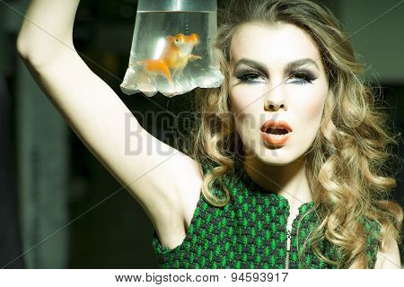 Tempting Girl With Goldfish