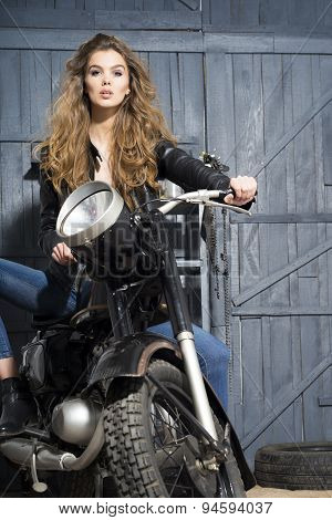 Biker Girl In Garage