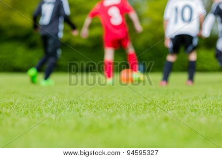 Blurred Kids Playing Youth Football Match