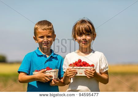 Two Happy Kids With Boxes Of Strawberries
