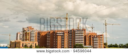 Group of construction cranes work
