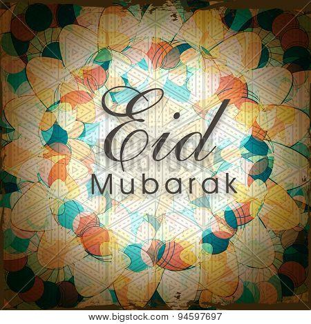 Stylish text Eid Mubarak on shiny floral design decorated background for Muslim community festival celebration.