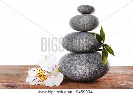 Stack of spa stones with flower isolated on white