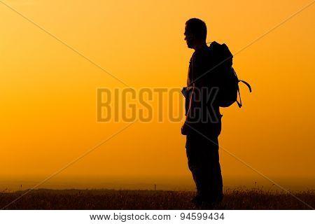 Hiker enjoys watching sunset