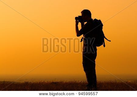 Hiker photographing