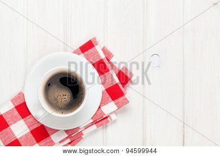 Coffee cup on white wooden table with copy space