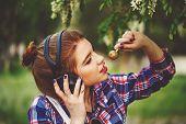 foto of lollipops  - Portrait of pretty attractive girl hipster headphones - JPG