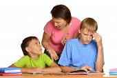 image of homework  - Mother is helping her kids with their homework - JPG