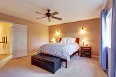 pic of master bedroom  - Beautiful master bedroom with carpet and floral bedding - JPG