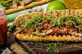 foto of cheese-steak  - Steak sandwich with herbs lime and microgreens with little bit kick of hot sriracha souce - JPG