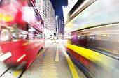 image of tram  - Blurred motino of tram and double decker in a busy road in Hong Kong - JPG