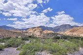 image of cumulus-clouds  - Beautiful scenic view of Aztec sandstone rock formations under cumulus clouds in Red Rock Canyon conservation area Nevada - JPG