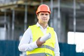 pic of scaffold  - Closeup portrait of construction manager posing against scaffolding - JPG