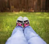 picture of lace  - a wide angle photo of a pair of generic looking shoes like converse sneakers with pink shoe laces  - JPG