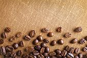 picture of sackcloth  - Frame of coffee beans on color sackcloth background - JPG