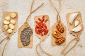 picture of pecan nut  - superfood abstract with price tags against barn wood  - JPG