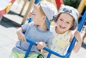 foto of matron  - happy little kids on the swing in the summer - JPG