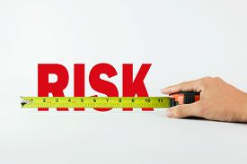 stock photo of risk  - Measure the word Risk with measuring tape on white background - JPG