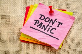 foto of panic  - Do not panic on a sticky note against burlap canvas  - JPG