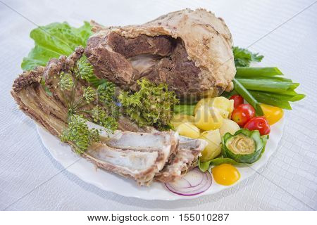 Boiled Mutton Laid Out On A Platter With Vegetables.