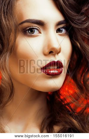Beauty Woman with Perfect Makeup Beautiful Professional Holiday Make-up. Red Lips and Nails Beauty Girls Face isolated on Black background Glamorous Woman close up