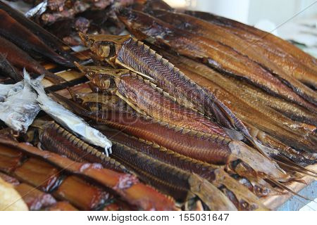 Smoked sturgeon is on the counter trading tray