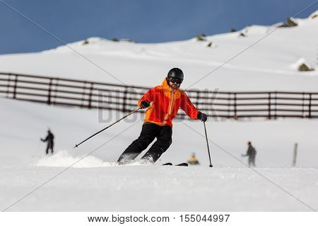 Male Skier Skiing On Ski Slope