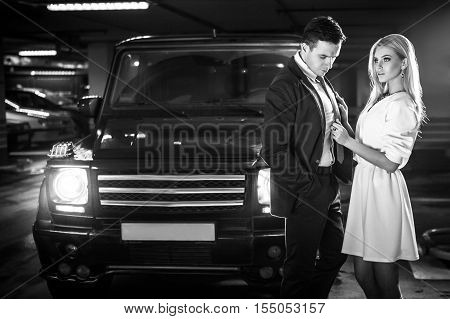 Sexy couple in the car. Hollywood stars. Fashionable look