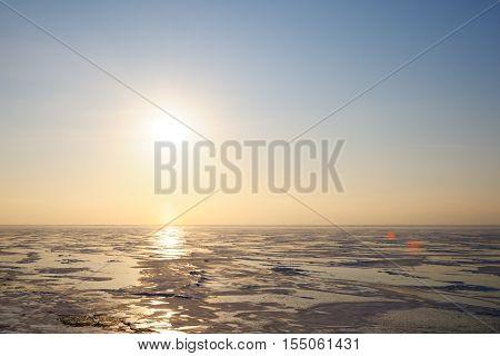 Frozen winter lake at sunrise in january