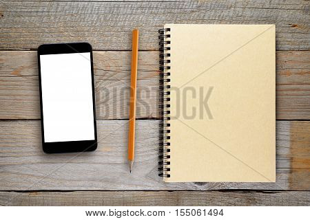 Smartphone pencil and notepad on wooden table